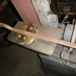 Flywheel dog & lever